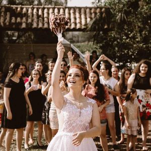 Bride about to throw bouquet.
