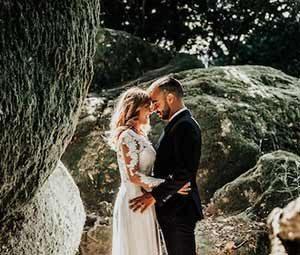 Bride and groom among giant boulders