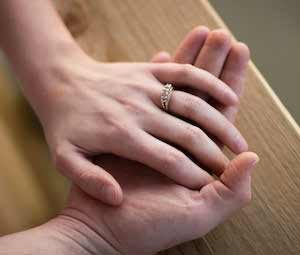 Brides hand in grooms
