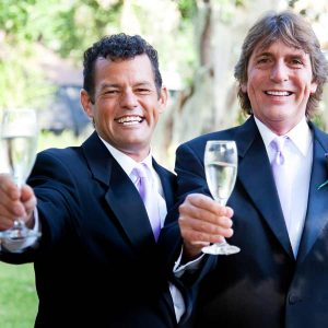 Gay couple toasting with champagne.