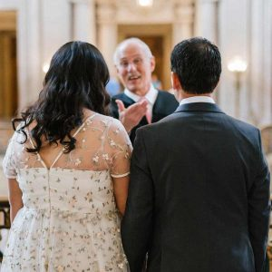 Officiator with Bride and Groom
