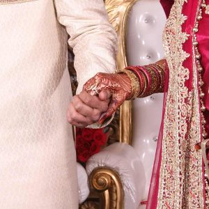 Indian Wedding Groom and Bride Holding Hands